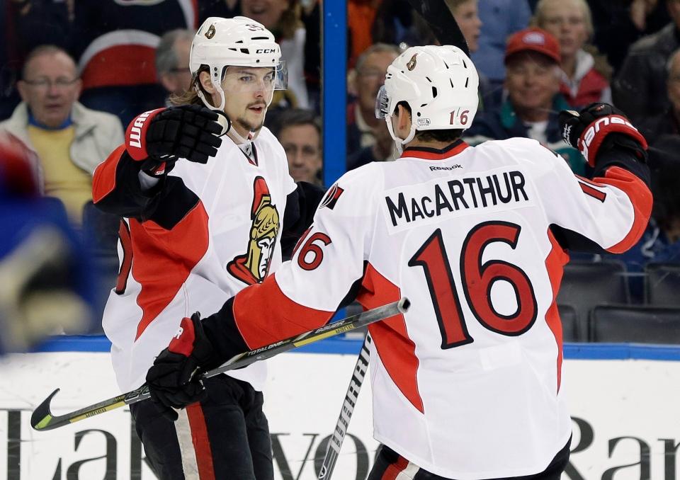 Ottawa Senators defenseman Erik Karlsson (65) celebrates his goal against the Tampa Bay Lightning with teammate Clarke MacArthur (16) during the first period of an NHL hockey game Thursday, Jan. 23, 2014, in Tampa, Fla. (AP / Chris O'Meara)