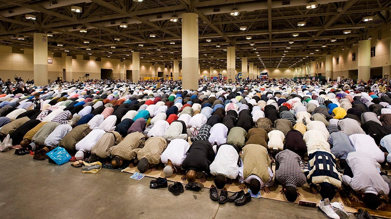 Muslims pray at the Muslim Association of Canada's Eid celebration that marks the end of the holiday of Ramadan at the Metro Convention Centre in Toronto on Tuesday, Aug. 30, 2011. (Aaron Vincent Elkaim / THE CANADIAN PRESS)
