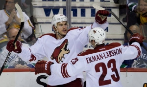 Phoenix Coyotes' Antoine Vermette, left, celebrates his third goal against the Vancouver Canucks with teammate Oliver Ekman-Larsson, of Sweden, during second period NHL hockey action in Vancouver, B.C., on Sunday January 26, 2014. (Darryl Dyck / THE CANADIAN PRESS)