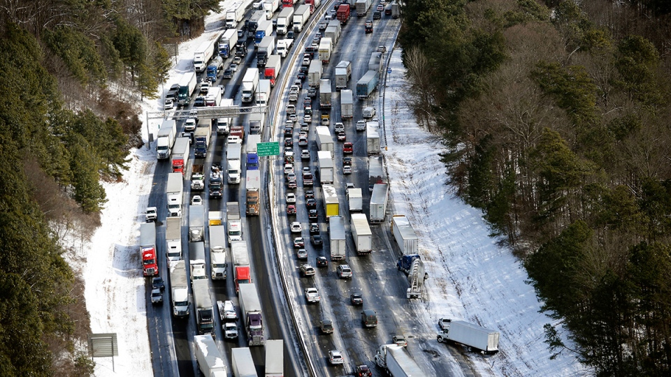 In this aerial photo, traffic is snarled along the I-285 perimeter north of the metro area after a winter snow storm, in Atlanta, Wednesday, Jan. 29, 2014. (AP / David Tulis)