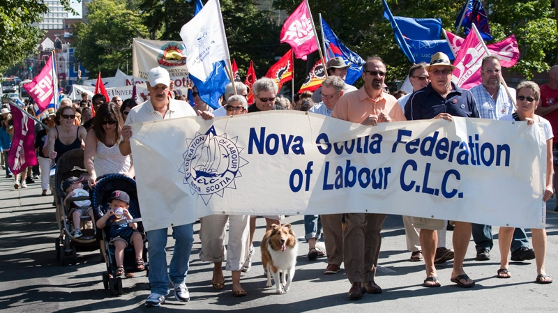 Workers march through city streets during a Labour Day rally in Halifax on Monday, Sept. 5, 2011. (Andrew Vaughan / THE CANADIAN PRESS)