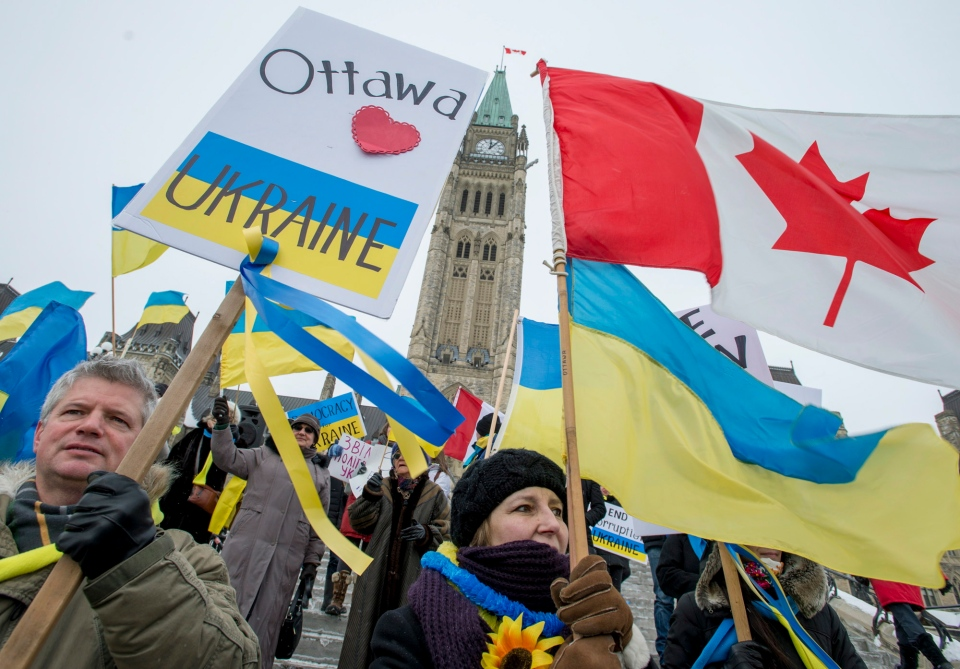 Members of the Ukrainian Canadian community rally on Parliament Hill in Ottawa, Wednesday, Jan. 29, 2014. (Justin Tang / THE CANADIAN PRESS)