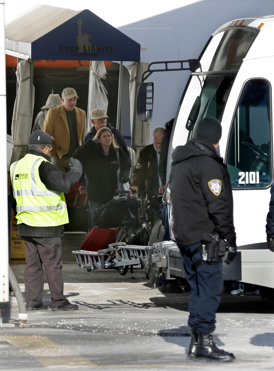 Passengers disembark from the Explorer of the Seas cruise ship to waiting buses after it docked in Bayonne, N.J., Wednesday, Jan. 29, 2014. (AP / Mel Evans)