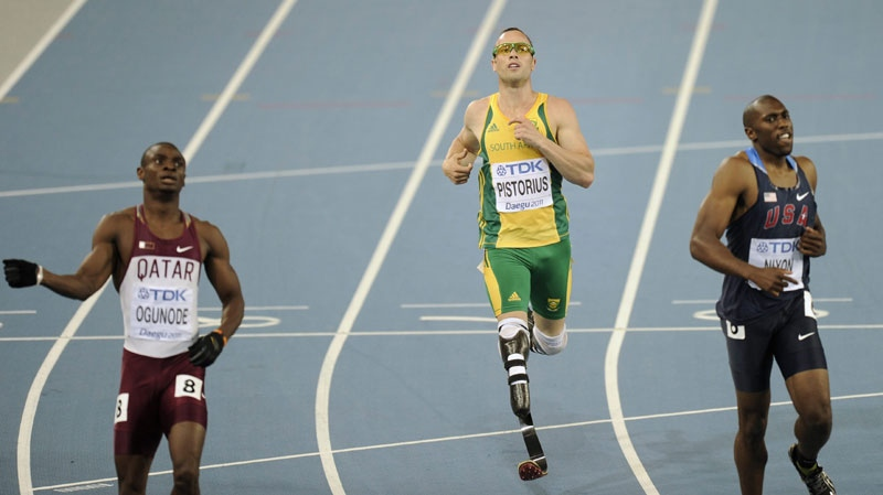 South Africa's Oscar Pistorius, center, crosses the finish last in a Men's 400m semifinal with USA's Greg Nixon, right, and Qatar's Femi Ogunode at the World Athletics Championships in Daegu, South Korea, Monday, Aug. 29, 2011. (AP Photo/Martin Meissner)