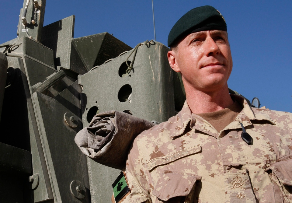 Brig. Gen. Daniel Menard, commander of Canada's Task Force Afghanistan, stands by a Light Armored Vehicle (LAV) in Kandahar Province, southern Afghanistan, Saturday, Jan. 30, 2010. (AP / Kirsty Wigglesworth)