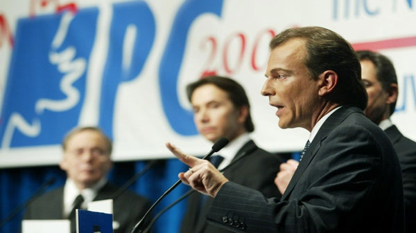 Progressive Conservative Andre Bachand (R-L) speaks during the PC National Leadership Debate in Ottawa Sunday March 2, 2003 as fellow Conservatives Jim Prentice, Scott Brison and Heward Gafftey look on. (CP PHOTO/Jonathan Hayward)