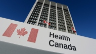 A sign is displayed in front of Health Canada headquarters in Ottawa on Friday, Jan. 3, 2014. (The Canadian Press/Sean Kilpatrick)