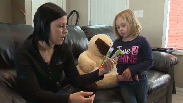 Manitoba mom Leona Friesen and her seven-year-old daughter Zoe Loewen are shown on Jan. 30, 2014. Zoe is one of nearly 2.5 million Canadians who suffer from a food allergy.