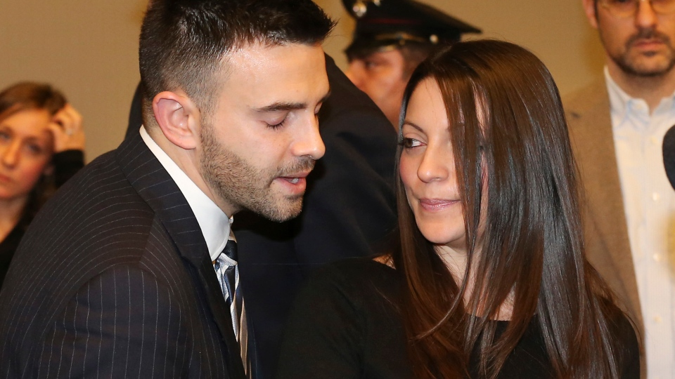 Meredith Kercher's brother Lyle, left, and sister Stephanie talk after the reading of the verdict for the murder of British student Meredith Kercher, in Florence, Italy, Thursday, Jan. 30, 2014. (AP / Antonio Calanni )