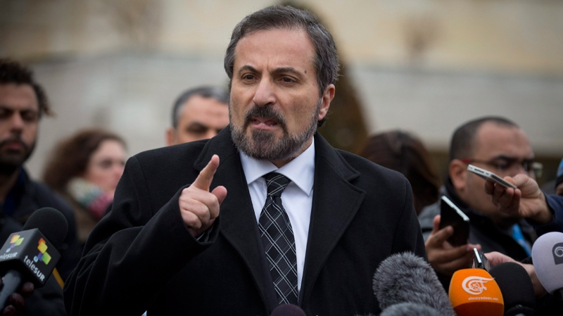 Louay Safi, centre, spokesperson for the Syrian National Coalition, Syria's main political opposition group, gestures during a press briefing at the United Nations headquarters in Geneva, Switzerland, Thursday, Jan. 30, 2014. (AP / Anja Niedringhaus)