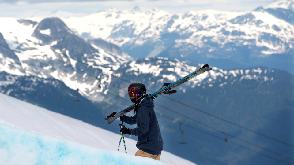 Rosalind Groenewoud of Calgary walks up the side of the half pipe on the Blackcomb Mountain in Whistler, B.C., Thursday, July 7, 2013. (Jonathan Hayward / THE CANADIAN PRESS)