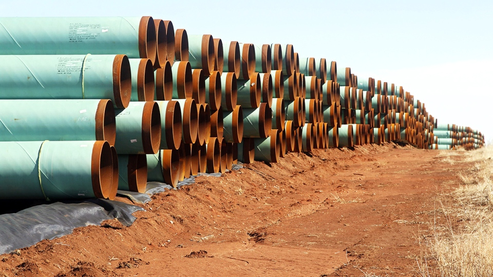 Pipe ready to become part of the Keystone XL Pipeline are stacked in a field near Ripley, Okla., Wednesday, Feb. 1, 2012. (AP / Sue Ogrocki)