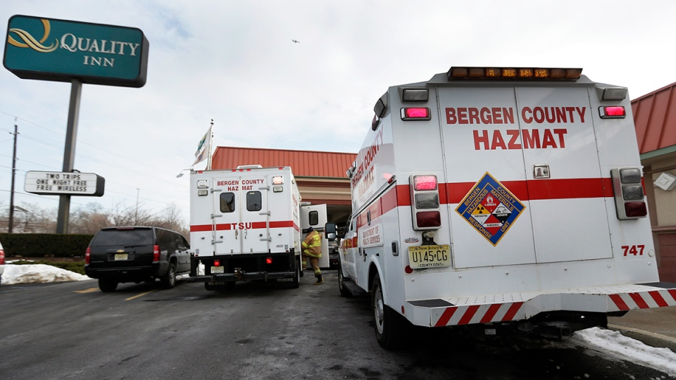 Emergency vehicles are parked outside a Quality Inn near the site of NFL Super Bowl XLVIII, in Lyndhurst, N.J., Friday, Jan. 31, 2014. (AP / Charlie Riedel)