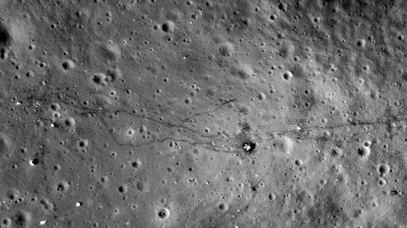 This August 2011 image made available by NASA shows paths left by walking astronauts, single lines, and lunar buggy tracks, parallel lines, from the 1972 U.S. Apollo 17 moon mission. NASA's Lunar Reconnaissance Orbiter made this and other photographs of lunar landing sites from 13 to 15 miles above the moon's surface.