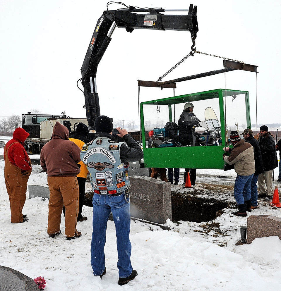 The family of Billy Standley, of Mechanicsburg, Ohio, carried out his wish to be buried on his 1967 Harley Davidson motorcycle, burying him in a large Plexiglas casket at Fairview Cemetery in Crawford County, Ohio, Friday, Jan. 31, 2014. (The News-Sun, Marshall Gorby)