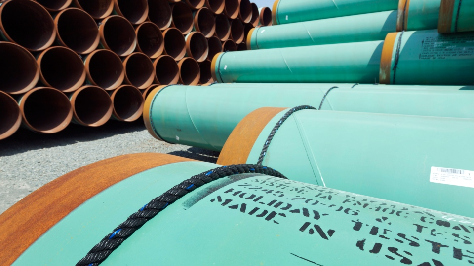 Some of about 500 miles worth of coated steel pipe manufactured by Welspun Pipes, Inc., originally for the Keystone oil pipeline, is stored in Little Rock, Ark. May 24, 2012. (AP / Danny Johnston)