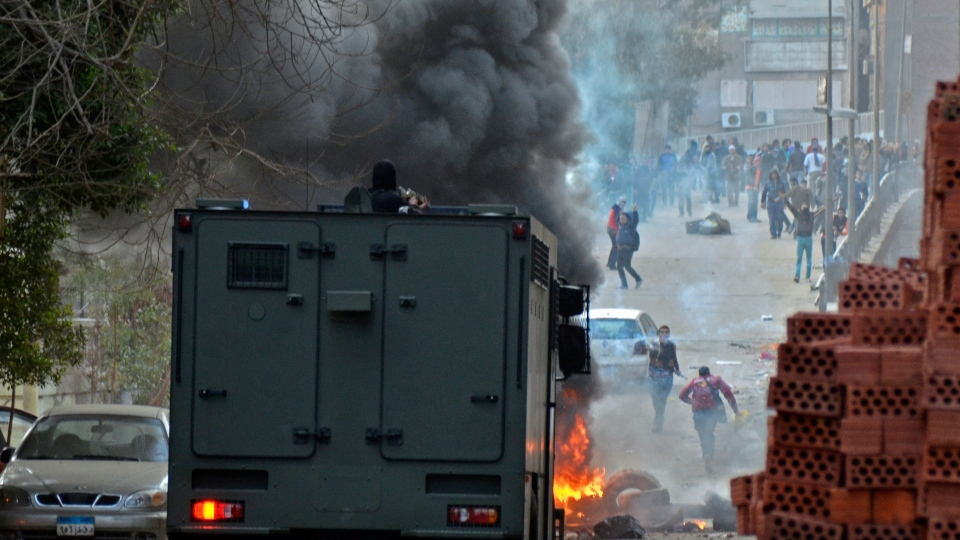 Egyptian security forces try to disperse supporters of Egypt's ousted President Mohammed Morsi protesting against the government in Cairo, Egypt, Friday, Jan. 31, 2014. (AP / Mostafa Darwish)
