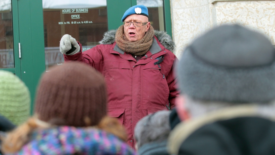 Canadian Forces veteran Martin Haller addresses veterans and supporters outside the Veterans Affairs Office in Brandon, Manitoba, on Friday, Jan. 31, 2014. (Tim Smith / THE CANADIAN PRESS)