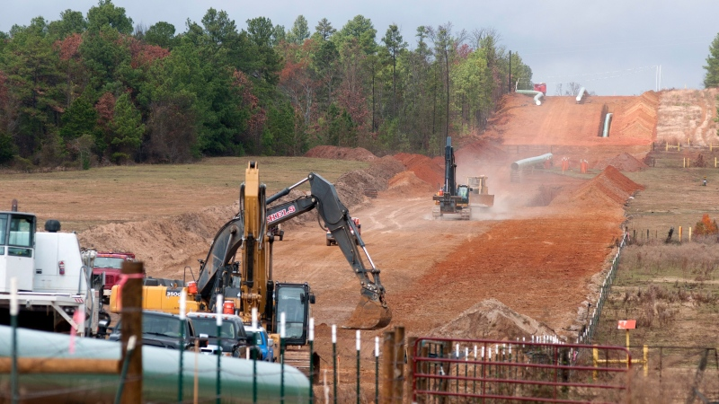 Crews work on construction of the TransCanada Keystone XL Pipeline near County Road 363 and County Road 357, east of Winona, Texas on Dec. 3, 2012. (AP / The Tyler Morning Telegraph, Sarah A. Miller)