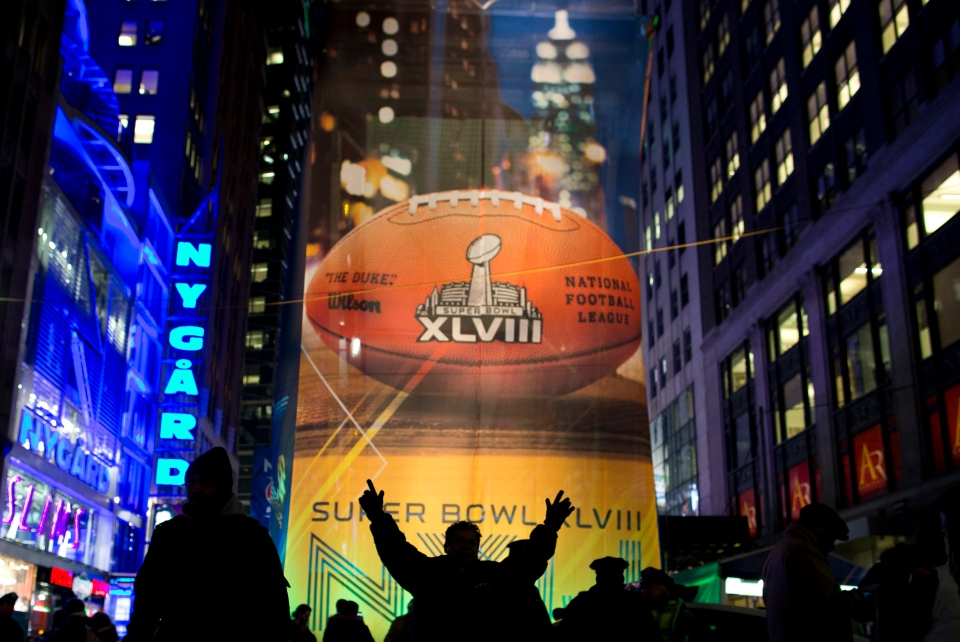 Fans gather on the Super Bowl Boulevard in Times Square on Friday, Jan. 31, 2014, in New York City. The Seattle Seahawks will play the Denver Broncos Sunday in Super Bowl XLVIII in East Rutherford, N.J. (AP /  Evan Vucci)