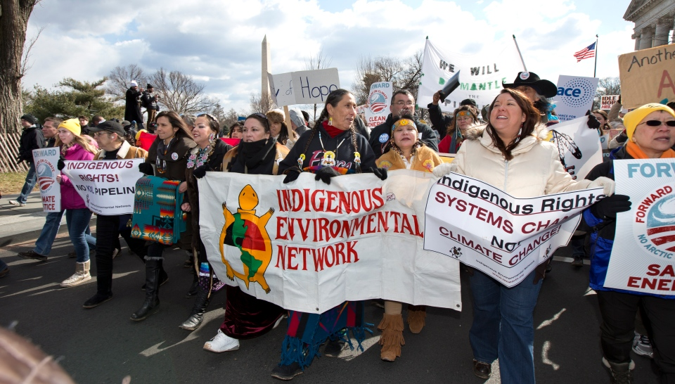 Native Americans march with other protestors from the National Mall to the White House in Washington during a rally calling on President Barack Obama to reject the Keystone XL oil pipeline from Canada on Feb. 17, 2013. (AP / Manuel Balce Ceneta)