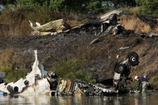 Wreckage of Russian Yak-42 jet, carrying a hockey team, seen near the city of Yaroslavl, on the Volga River about 240 km northeast of Moscow, Russia, Wednesday, Sept. 7, 2011. (AP / Misha Japaridze)