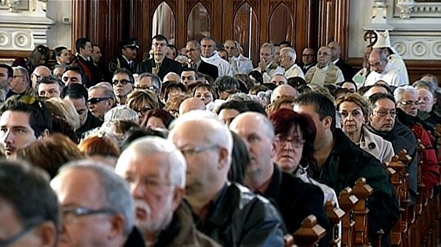 Mourners honour victims of a tragic retirement home blaze at a public memorial in L'Isle-Verte, Que., Saturday, Feb. 1, 2014.