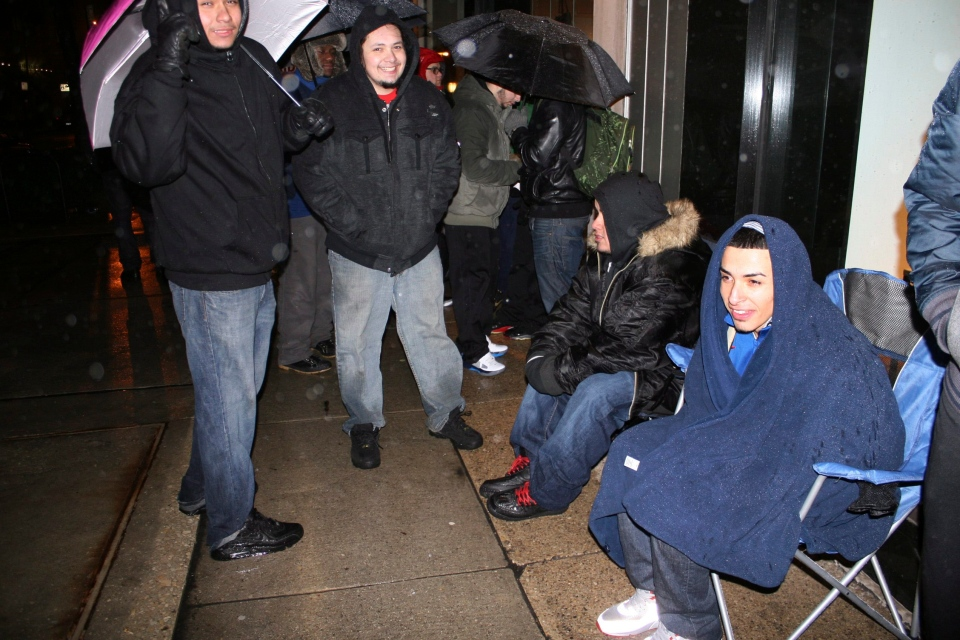 "In this photo taken Feb. 23, 2012, self-proclaimed ""sneakerheads"" camp out overnight in freezing rain outside a downtown Chicago shoe store for a release of limited edition Nike basketball shoes.  (AP Photo/Martha Irvine)"
