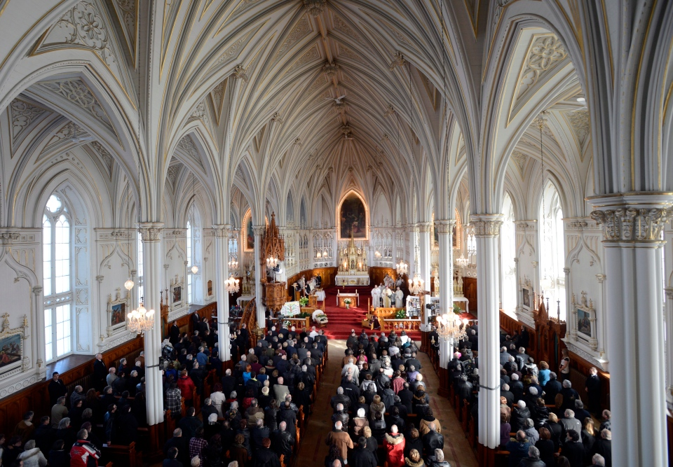 People attend a memorial service at the St. Jean Baptiste church in L'Isle-Verte, Que., Saturday, Feb. 1, 2014. (Ryan Remiorz / THE CANADIAN PRESS)