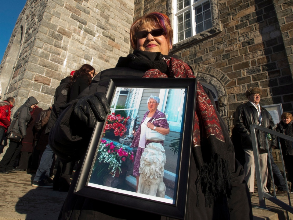 Marie Caron holds a photo of her aunt Jacqueline Caron, 89, one of the victims of the seniors' residence fire in L'Isle-Verte, Que. on Saturday, Feb. 1, 2014. (Ryan Remiorz/THE CANADIAN PRESS)