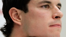 Pittsburgh Penguins' Sidney Crosby, listens during an NHL hockey conference to discuss his recovery from a concussion he suffered in January 2011 during an NHL hockey news conference in Pittsburgh on Wednesday, Sept. 7, 2011. (AP / Gene J. Puskar)
