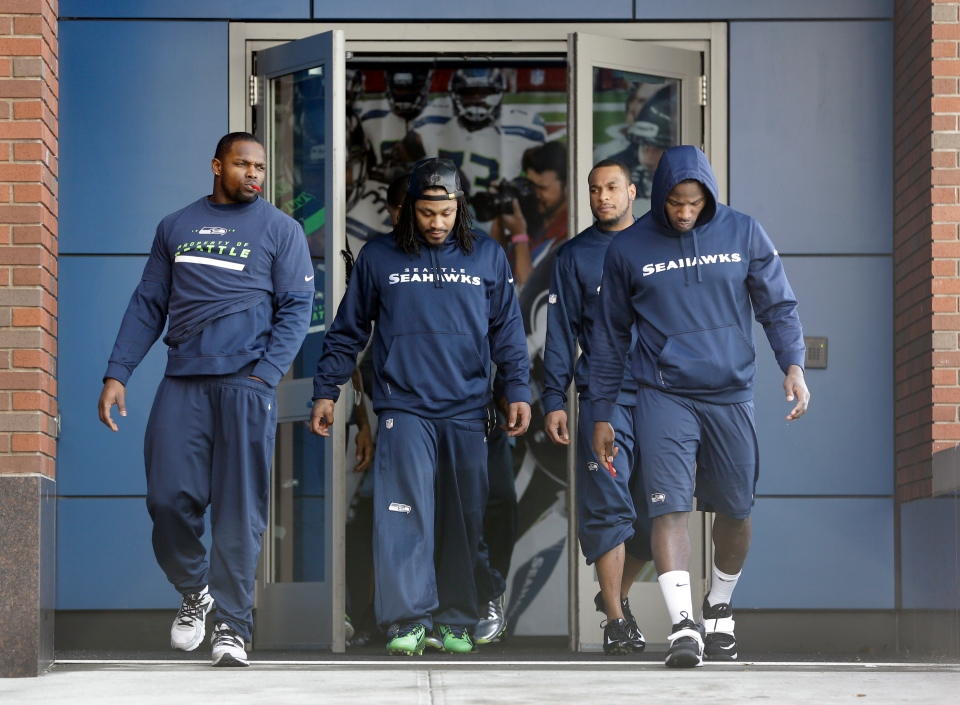 Seattle Seahawks, from left to right, Robert Turbin, Marshawn Lynch, Percy Harvin and Derrick Coleman walk to the New York Giants' NFL practice facility for a final walkthrough in East Rutherford, N.J., Saturday, Feb. 1, 2014. (AP / Jeff Roberson)