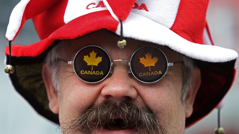 A proud Canadian wears maple leaf glasses while attending Canada Day festivities on Thursday July 1, 2010. (Darryl Dyck / THE CANADIAN PRESS)