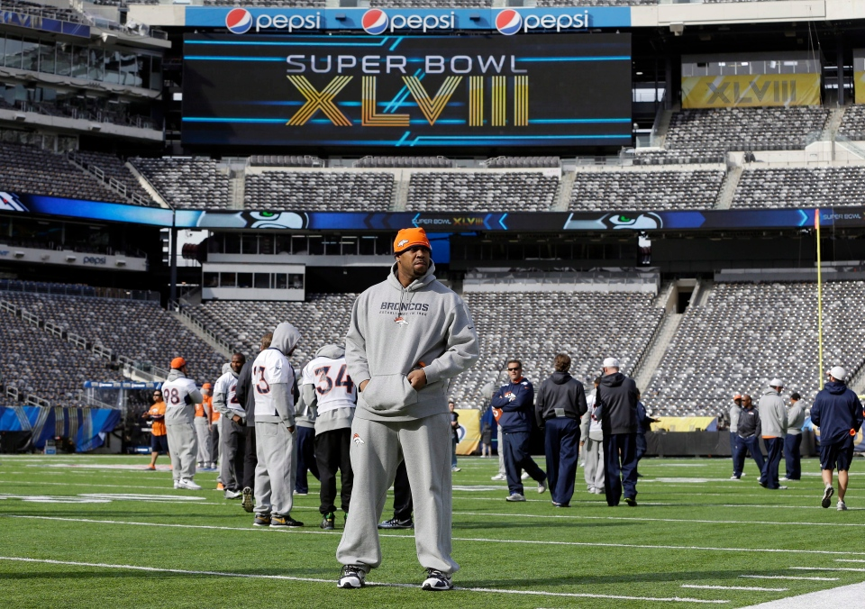 Denver Broncos players look around MetLife Stadium before the team's walk-through in East Rutherford, N.J. on Saturday, Feb. 1, 2014. (AP / Mark Humphrey)