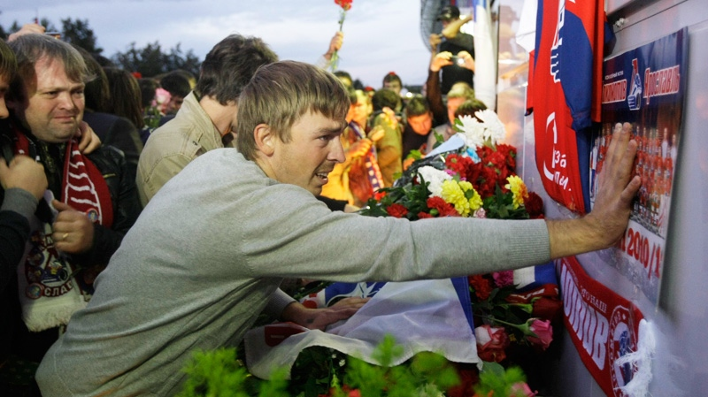 Fans of the Lokomotiv ice hockey team lay flowers and light candles at the Lokomotiv Arena to pay tribute to the Lokomotiv players killed in a plane crash, in the city of Yaroslavl, on the Volga River, Wednesday, Sept. 7, 2011. (AP / Misha Japaridze)
