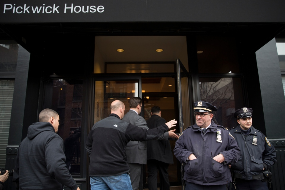 Police stand guard outside the home of actor Philip Seymour Hoffman who was found dead in his Greenwich village apartment,  in New York on Sunday, Feb. 2, 2014.(AP / John Minchillo)