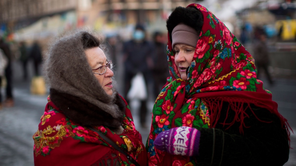 Two women talk to each other in Kiev's Independence Square, the epicenter of the country's current unrest, Ukraine, Saturday, Feb. 1, 2014. (AP / Emilio Morenatti)