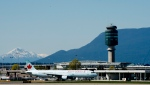 A plane is seen on the runway of YVR international airport in Vancouver, B.C. Monday, May 6, 2013. (Jonathan Hayward/The Canadian Press)