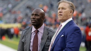 Denver Broncos Executive Vice President of Football Operations John Elway, right, and former Denver Bronco Terrell Davis watch pre game activity at MetLife Stadium before the NFL Super Bowl XLVIII football game between the Seattle Seahawks and the Denver Broncos Sunday, Feb. 2, 2014, in East Rutherford, N.J. (AP / Mark Humphrey)