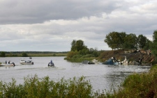 Rescuers lift a stretcher with the body of a victim out of the river, at the crash site of Russian Yak-42 jet near the city of Yaroslavl, on the Volga River about 240 km northeast of Moscow, Russia, Wednesday, Sept. 7, 2011. (AP / Misha Japaridze)