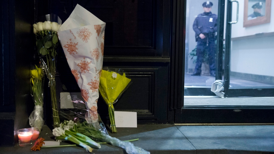 Flowers are seen out side the home of Philip Seymour Hoffman, Sunday, Feb. 2, 2014, in New York. Hoffman, who won an Oscar for best actor in 2006 for his portrayal of writer Truman Capote in 'Capote,' was found dead Sunday in his apartment. He was 46. (AP / Matt Rourke)