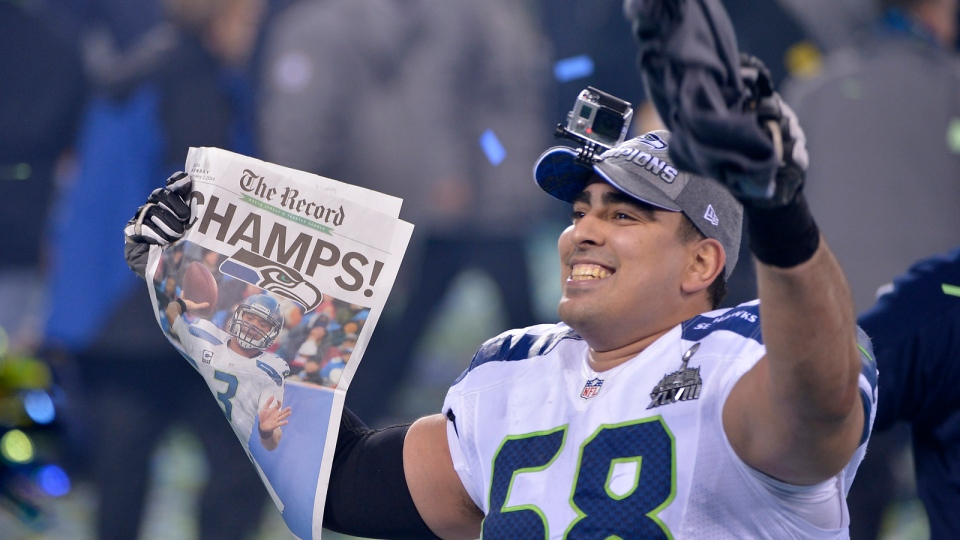 Seattle Seahawks' Breno Giacomini (68) celebrates after the NFL Super Bowl XLVIII football game against the Denver Broncos Sunday, Feb. 2, 2014, in East Rutherford, N.J. The Seahawks won 43-8. (AP / Bill Kostroun)
