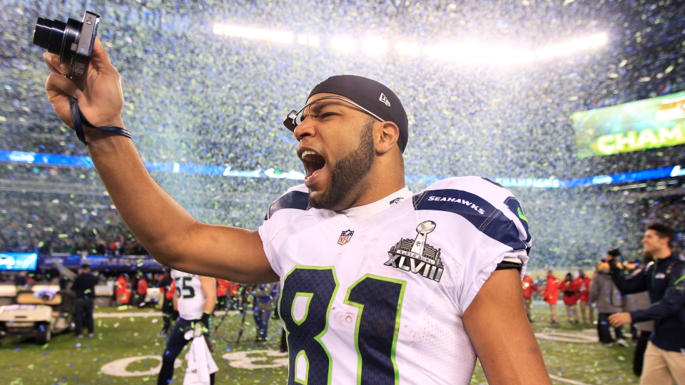 Seattle Seahawks' Golden Tate celebrates after the NFL Super Bowl XLVIII football game against the Denver Broncos in East Rutherford, N.J., Sunday, Feb. 2, 2014. (AP / Jeff Roberson)