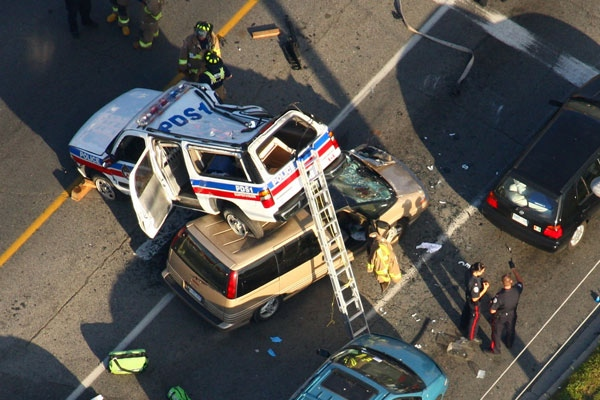 A police vehicle ended up on top of a van after a collision with a third vehicle on Victoria Park Ave. in Toronto, Tuesday, July 15, 2008. (Tom Podolec for CTV.ca)
