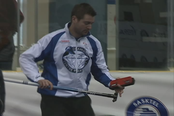 Brock Virtue was ejected from Sunday's Tankard final after breaking the head off his broom following a missed shot.