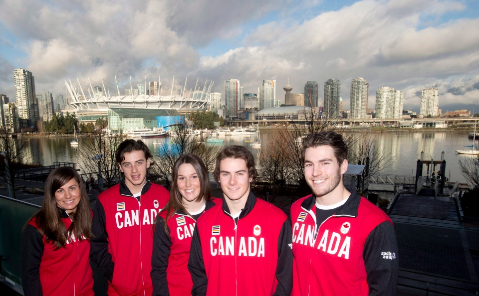 Members of the Canadian snowboard team Maelle Ricker, left to right, Mark McMorris, Spencer O'Brien, Sebastien Toutant and Chris Robanske pose for a photo following the team announcement in Vancouver, Friday, Jan. 3, 2014. (Jonathan Hayward / THE CANADIAN PRESS)