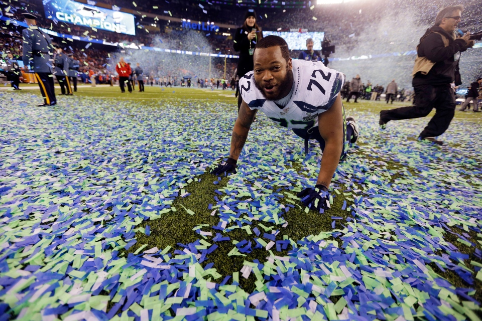 Seattle Seahawks' Michael Bennett celebrates after the NFL Super Bowl XLVIII football game in East Rutherford, N.J., Sunday, Feb. 2, 2014. (AP / Ben Margot)