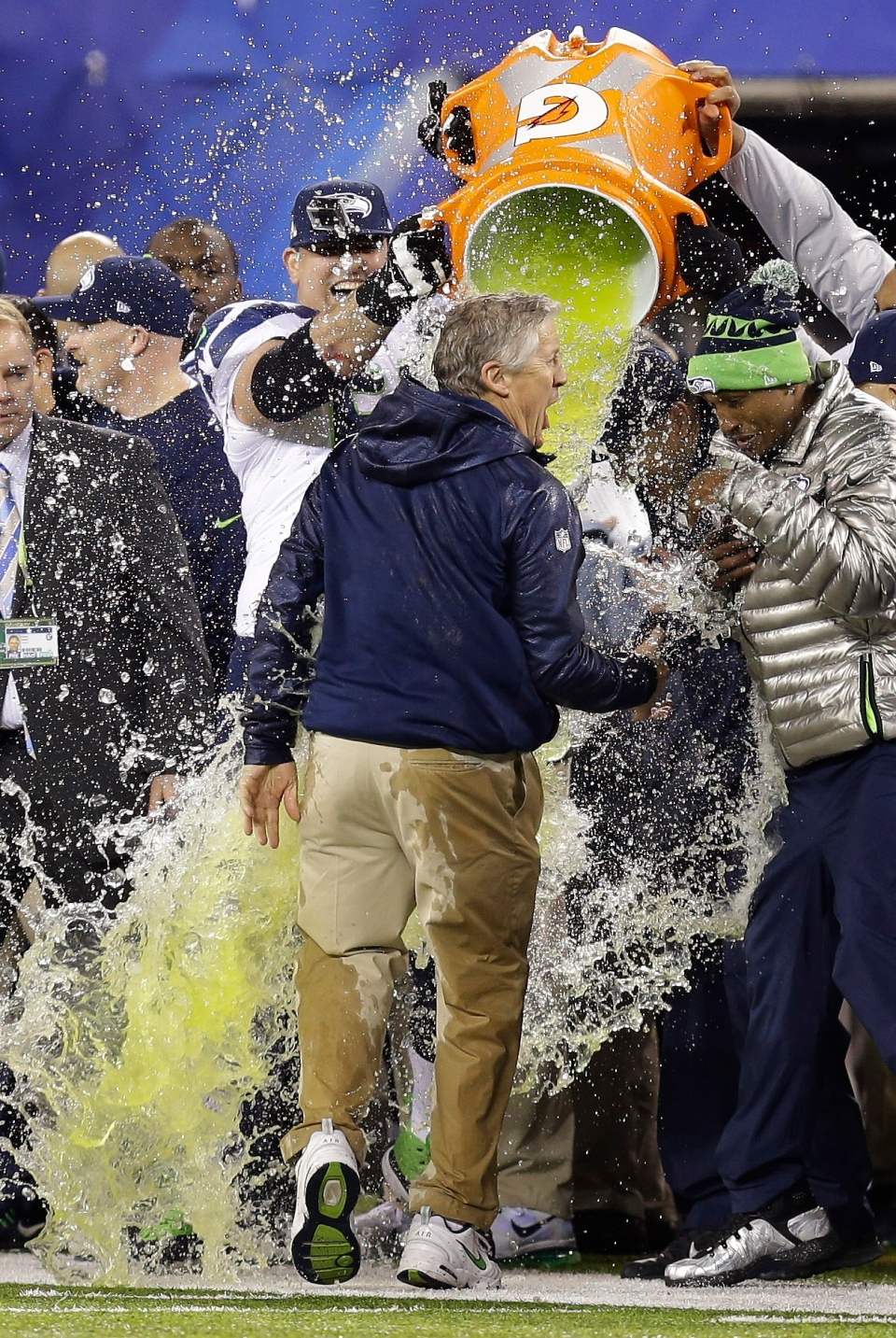 Seattle Seahawks head coach Pete Carroll is doused with Gatorade in the final minutes of the NFL Super Bowl XLVIII football game against the Denver Broncos in East Rutherford, N.J., Sunday, Feb. 2, 2014. (AP / Ben Margot)