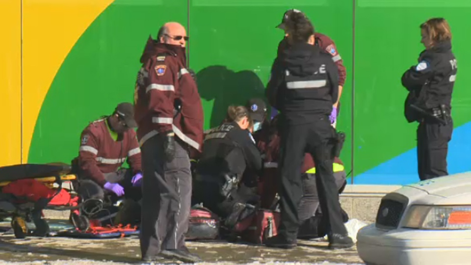 Paramedics and police officers at Berri St. and Ontario St., where police officers shot a man holding a hammer (Feb. 3, 2014)