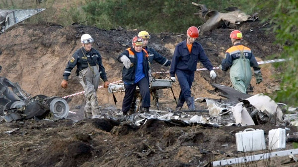 Rescuers carry a stretcher with the body of a victim at the crash site of the Russian Yak-42 jet near the city of Yaroslavl, on the Volga River about 150 miles (240 kilometres) northeast of Moscow, Russia, Wednesday, Sept. 7, 2011. (AP / Misha Japaridze)